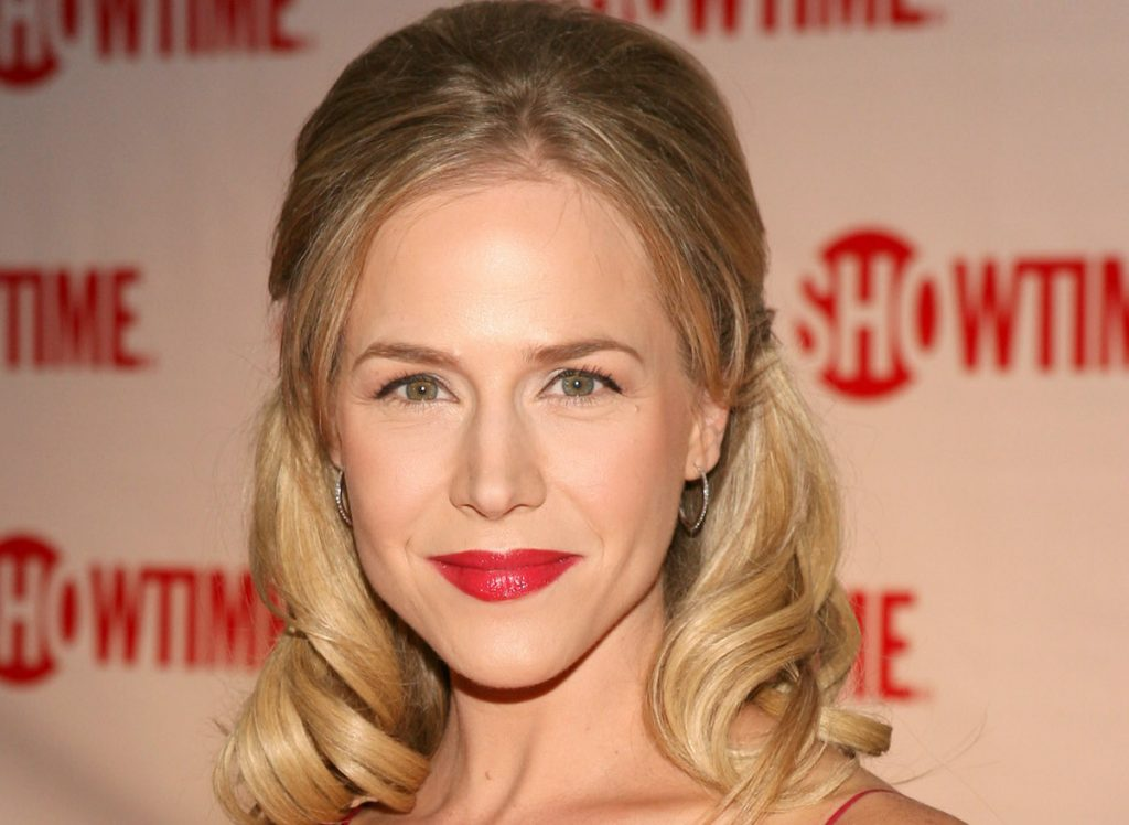Julie Benz smiling for a photo at an event for the Showtime series 'Dexter'