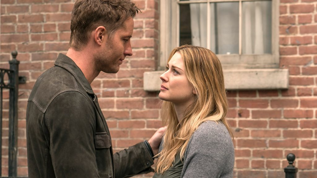 Justin Hartley as Kevin and Alexandra Breckenridge as Sophie look at each other with concerned expressions in 'This Is Us' Season 1