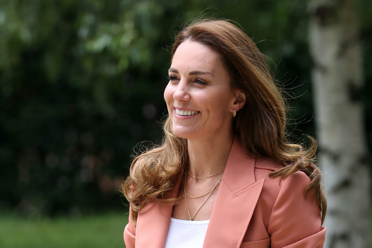 Duchess of Cambridge Kate Middleton smiling, looking off camera