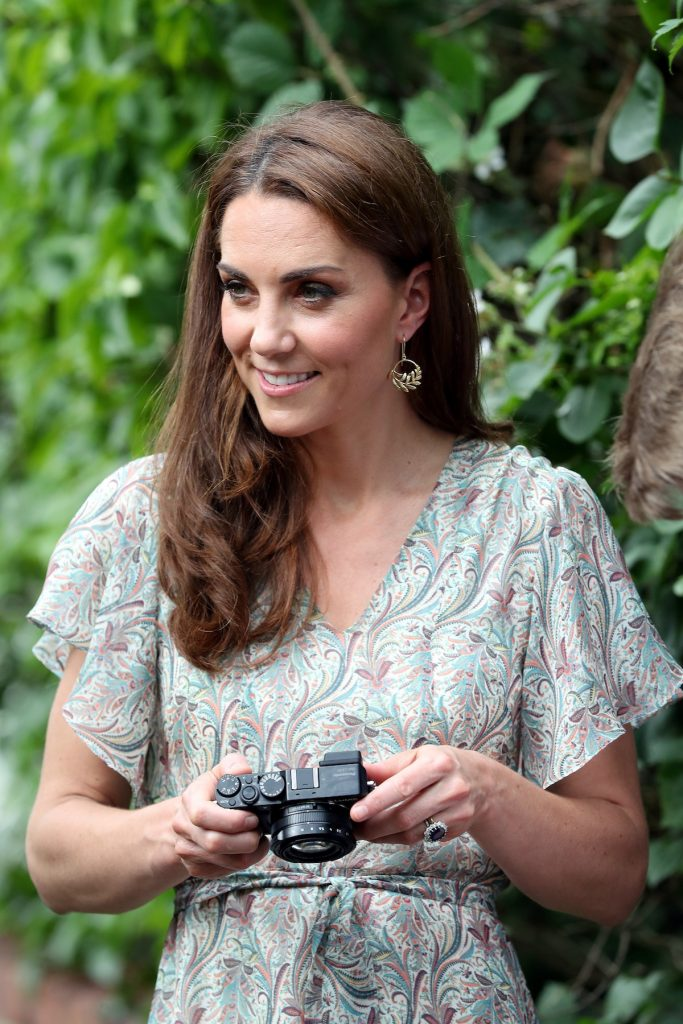 Kate Middleton holds a camera as she takes part in a 2019 charity photography workshop