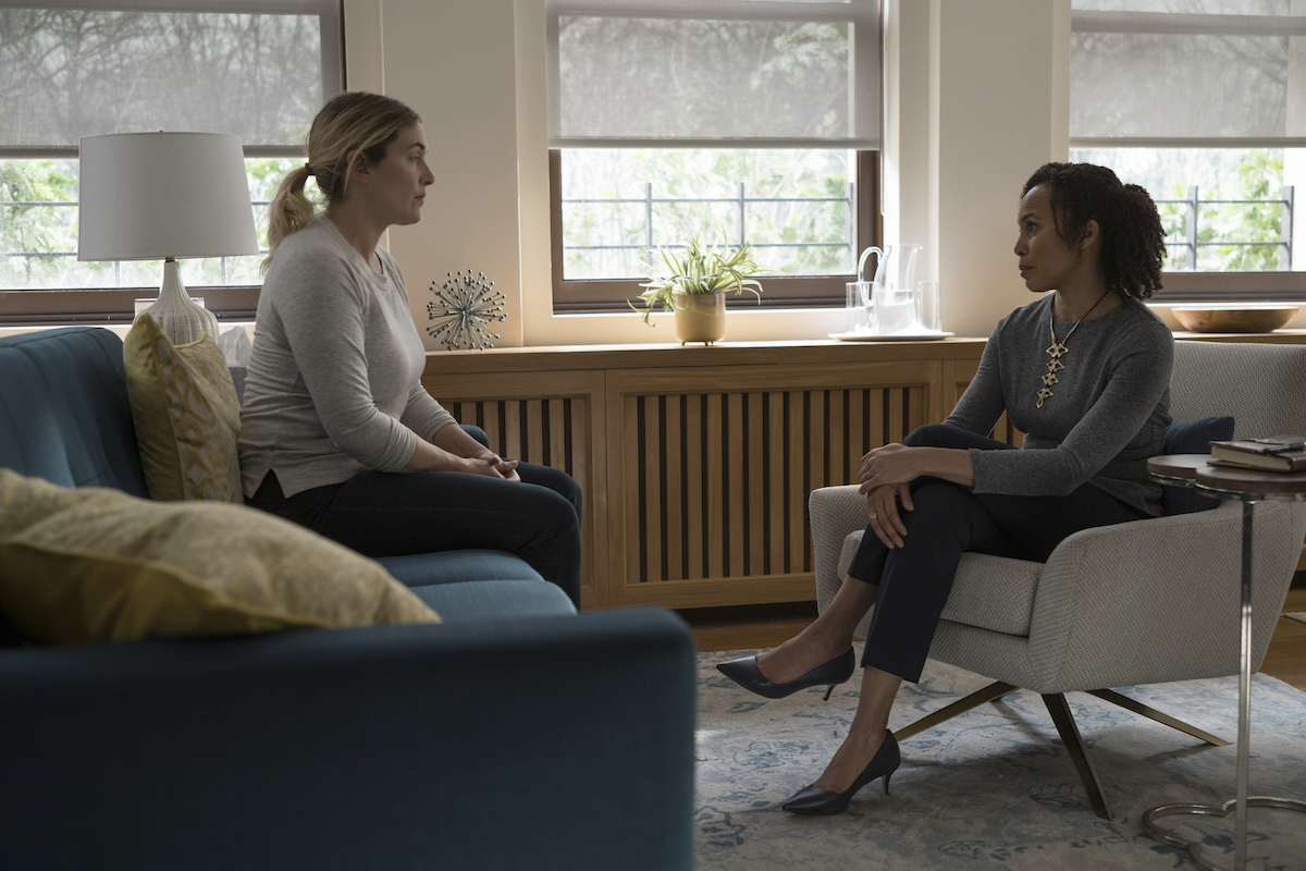 Kate Winslet sits on a couch across from Eisa Davis, who sits in a chair, on 'Mare of Easttown'