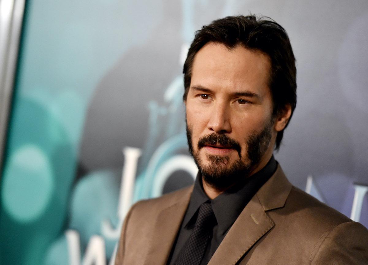 Keanu Reeves wears a suit at a screening of 'John Wick'