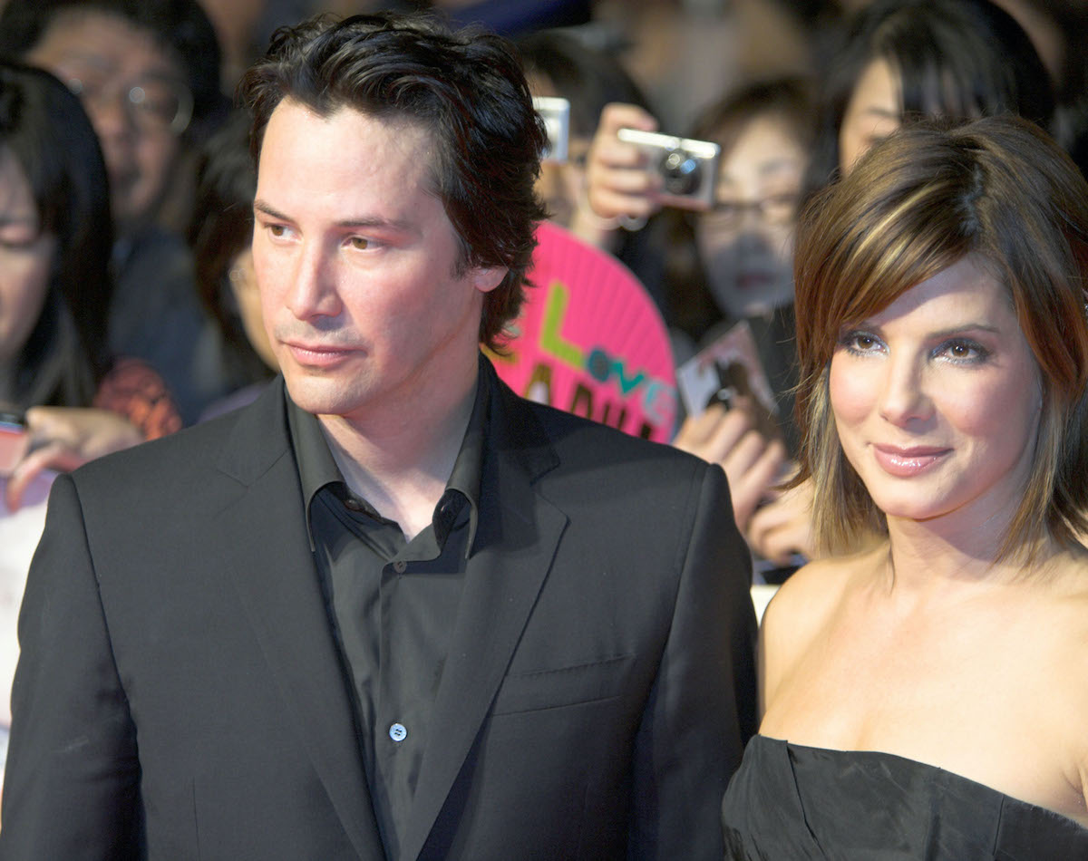 Keanu Reeves and Sandra Bullock walk the red carpet dressed in black during 'The Lake House' Tokyo premiere