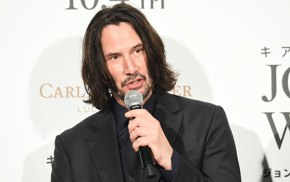 Keanu Reeves holds a microphone and speaks at the 'John Wick: Chapter 3 — Parabellum' Japan premiere