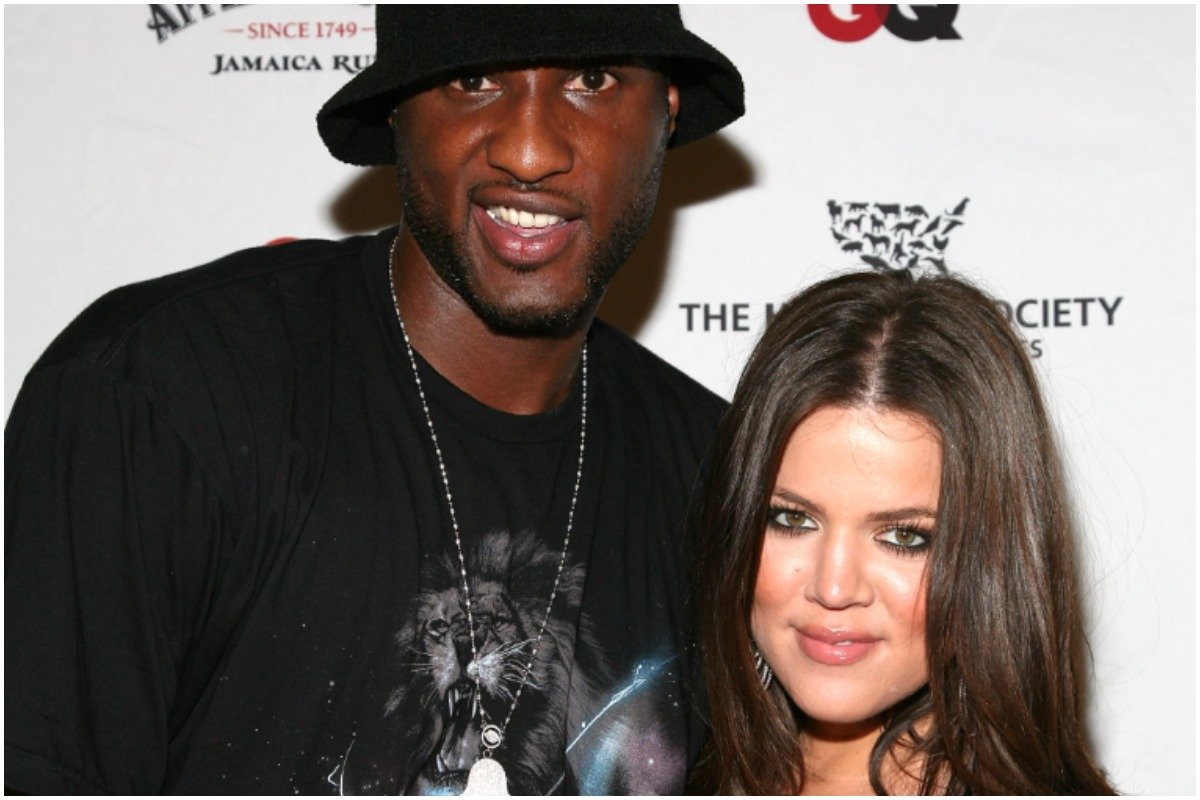 Khloé Kardashian and Lamar Odom smiling and posing at a red carpet event.