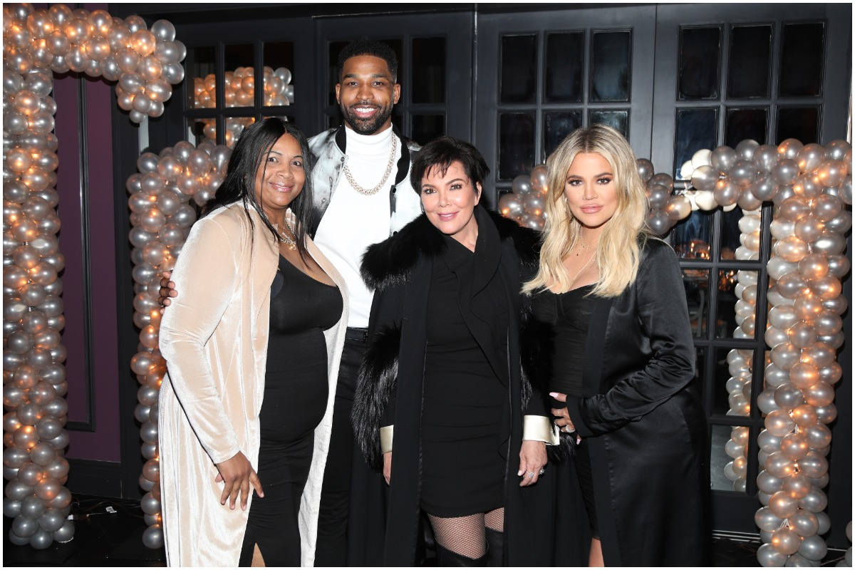 (L-R) Andrea Thompson, Tristan Thompson, Kris Jenner and Khloé Kardashian posing and smiling at the athete's birthday party.