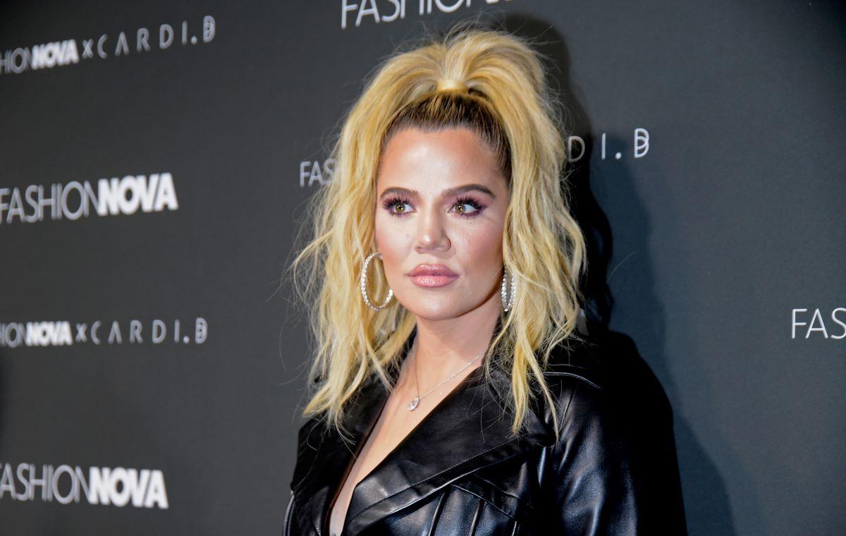 'KUWTK' star Khloe Kardashian in a black leather jacket, wearing a high ponytail