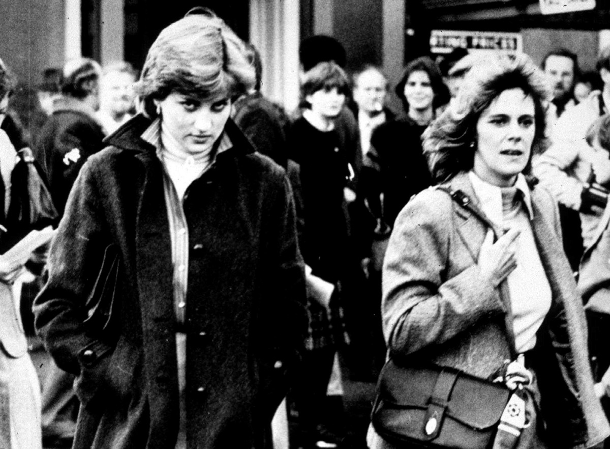 Princess Diana and Camilla Parker Bowles  walking side-by-side at the Ludlow Races where Prince Charles was competing in 1980