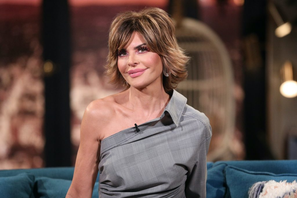 Lisa Rinna smiling in front of a blurred background