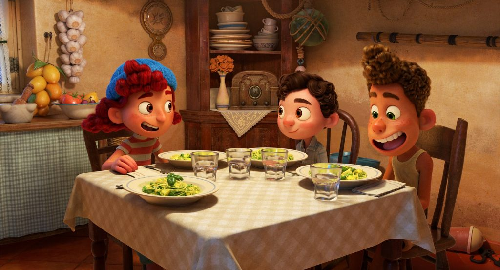 Luca and Alberto have dinner with Giulia in the Luca movie