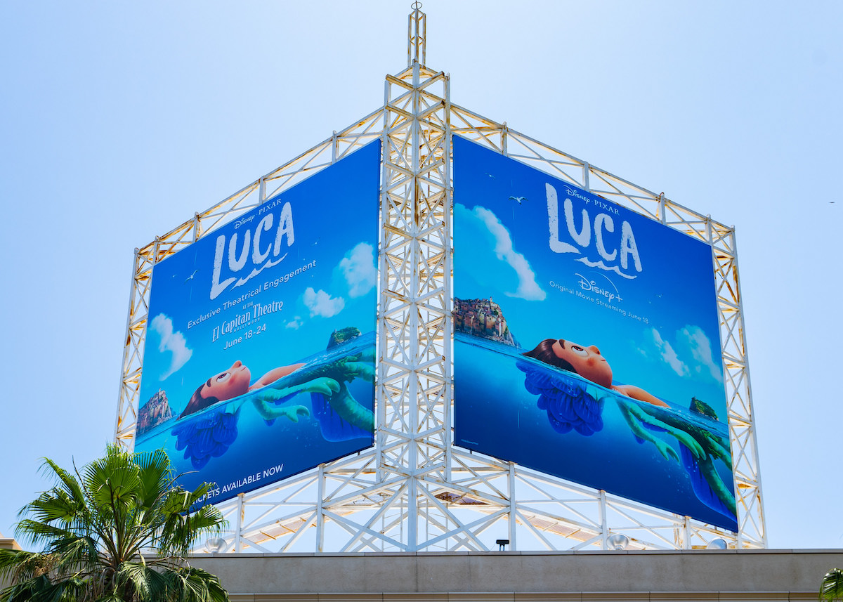 A double billboard of the new Pixar film 'Luca' featuring the lead character laying in water