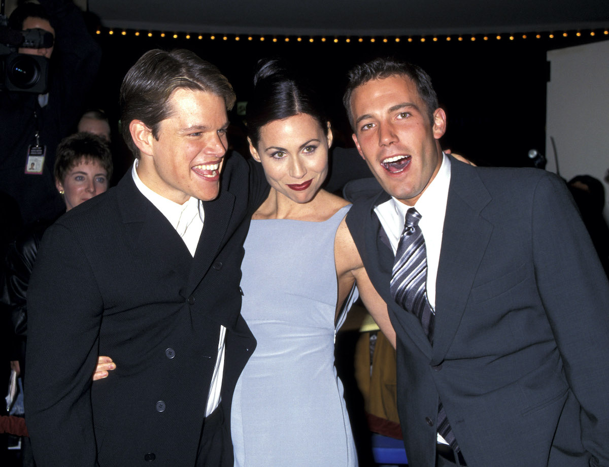 Matt Damon, Minnie Driver and Ben Affleck smile and pose at a red carpet event