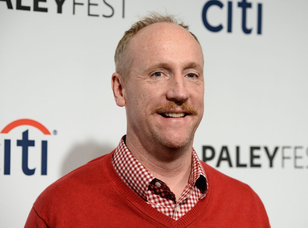 Matt Walsh smiling in front of a white background