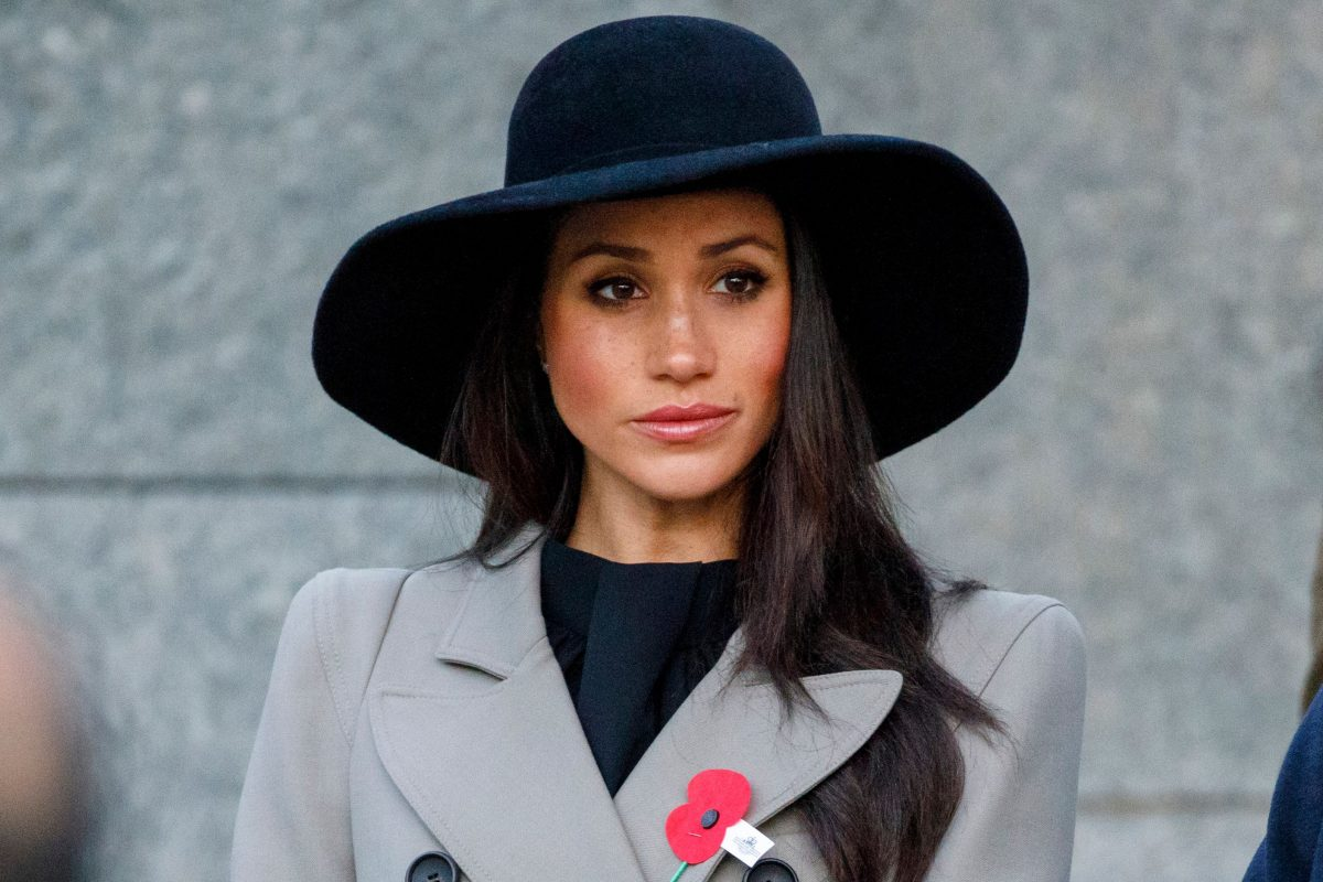 Meghan Markle dressed in a black and grey coat at Anzac Day dawn service