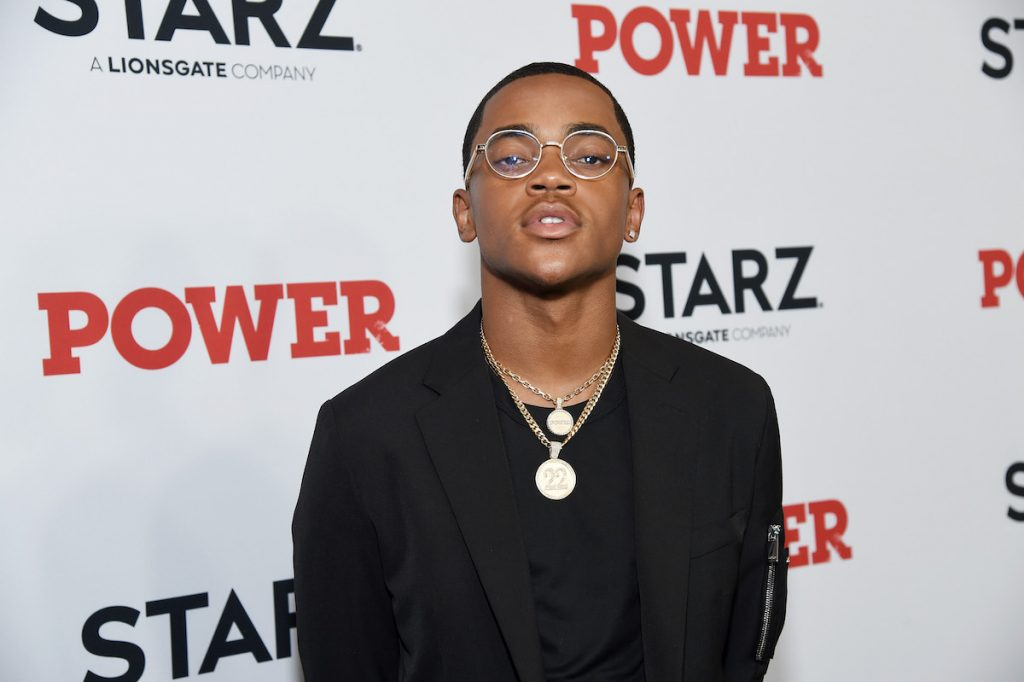 Michael Rainey Jr. wearing glasses and gold chains