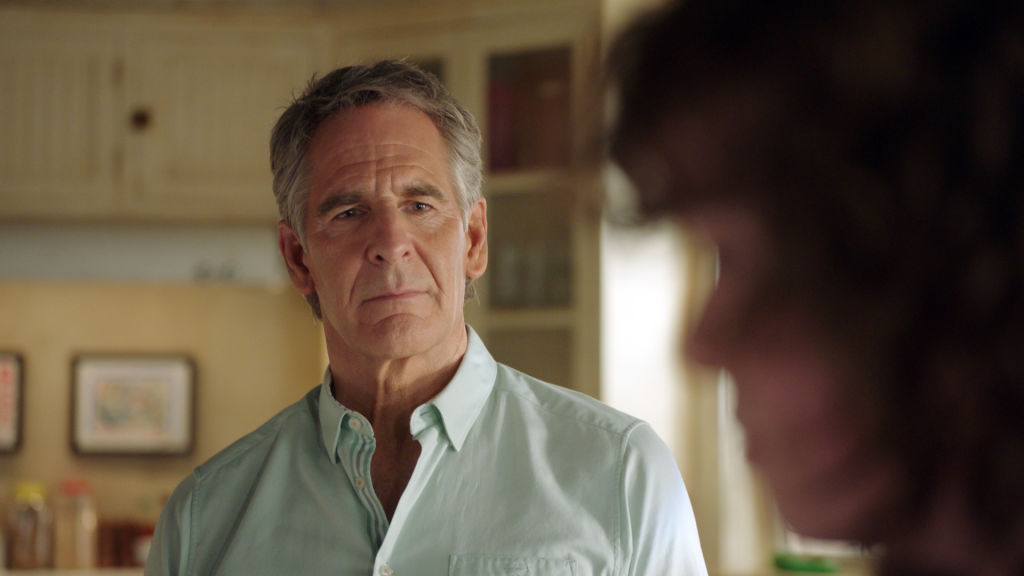 Scott Bakula as Special Agent Dwayne Pride looks on with concern. He's wearing a light blue shirt.