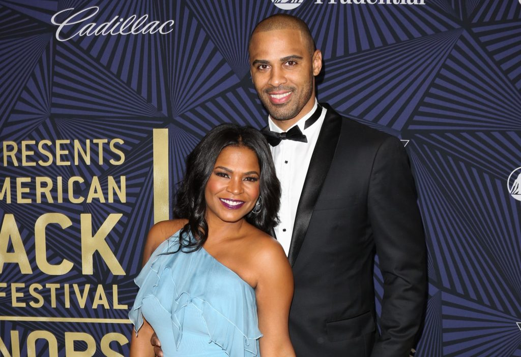 Nia Long and Ime Udoka pose for a photo together on carpet at the BET Awards