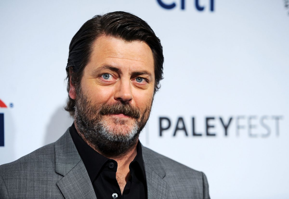 'Parks and Recreation' star Nick Offerman wearing a grey suit and standing in front of a PaleyFest wall