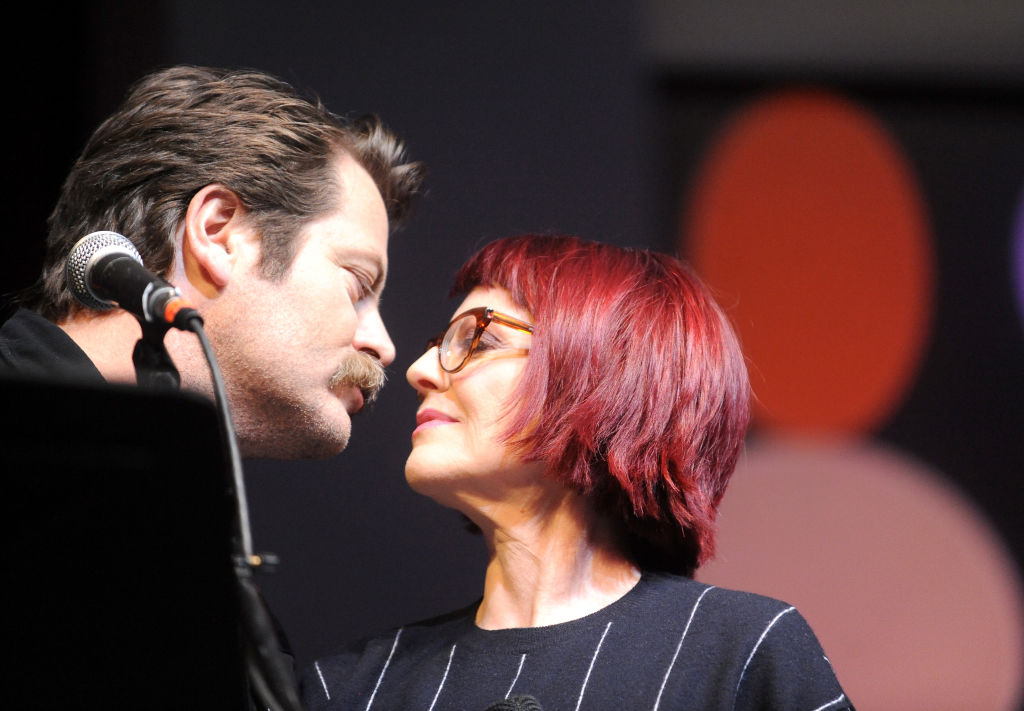 Nick Offerman and Megan Mullally look longingly into each other's eyes.