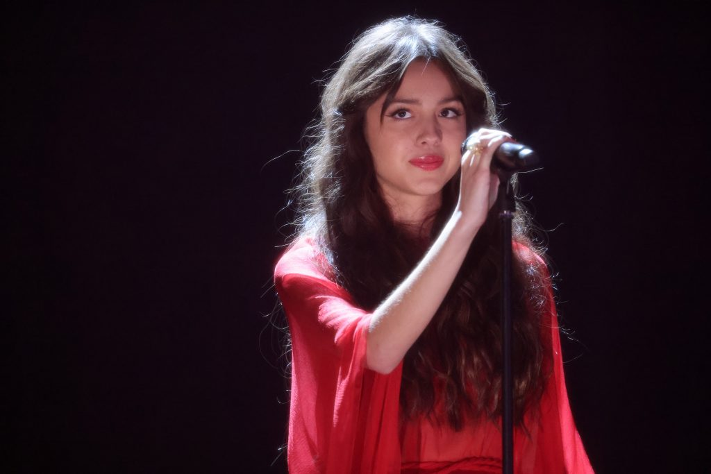 Olivia Rodrigo performed during The BRIT Awards 2021 in a red dress