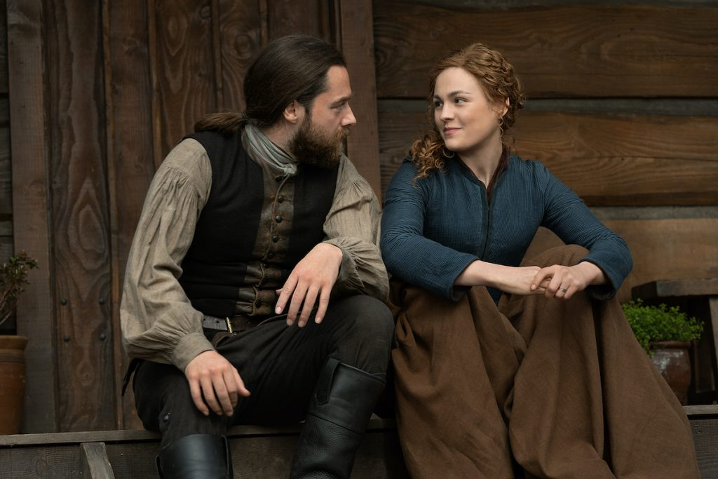 Richard Rankin and Sophie Skelton in 1770s colonial clothing as Roger and Brianna in 'Outlander' Season 6