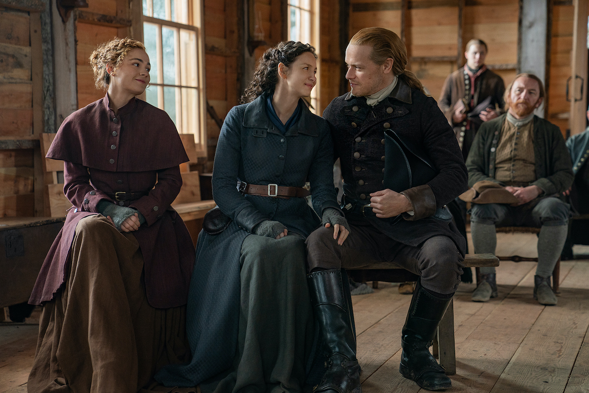 Sophie Skelton, Caitriona Balfe, and Sam Heughan in 1770s colonial clothing as Brianna, Claire, and Jamie in 'Outlander' Season 6