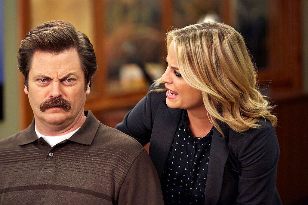 Amy Poehler as Leslie Knope yells at a stone-faced Nick Offerman as Ron Swanson.