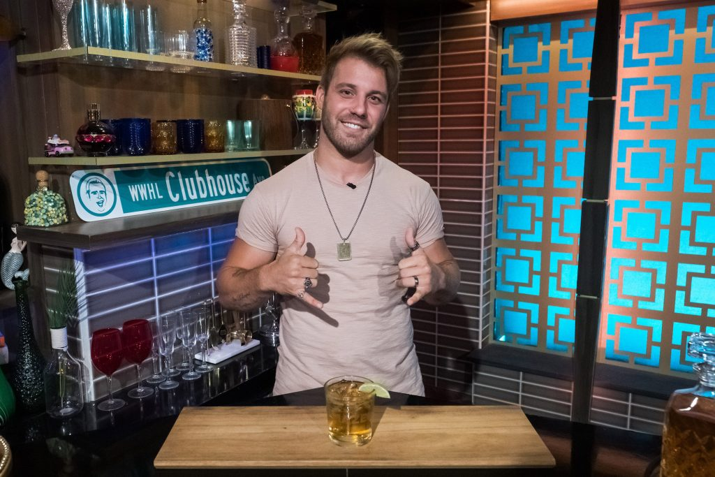 Paulie Calafiore from MTV's 'The Challenge' smiling in a kitchen on 'Watch What Happens Live'