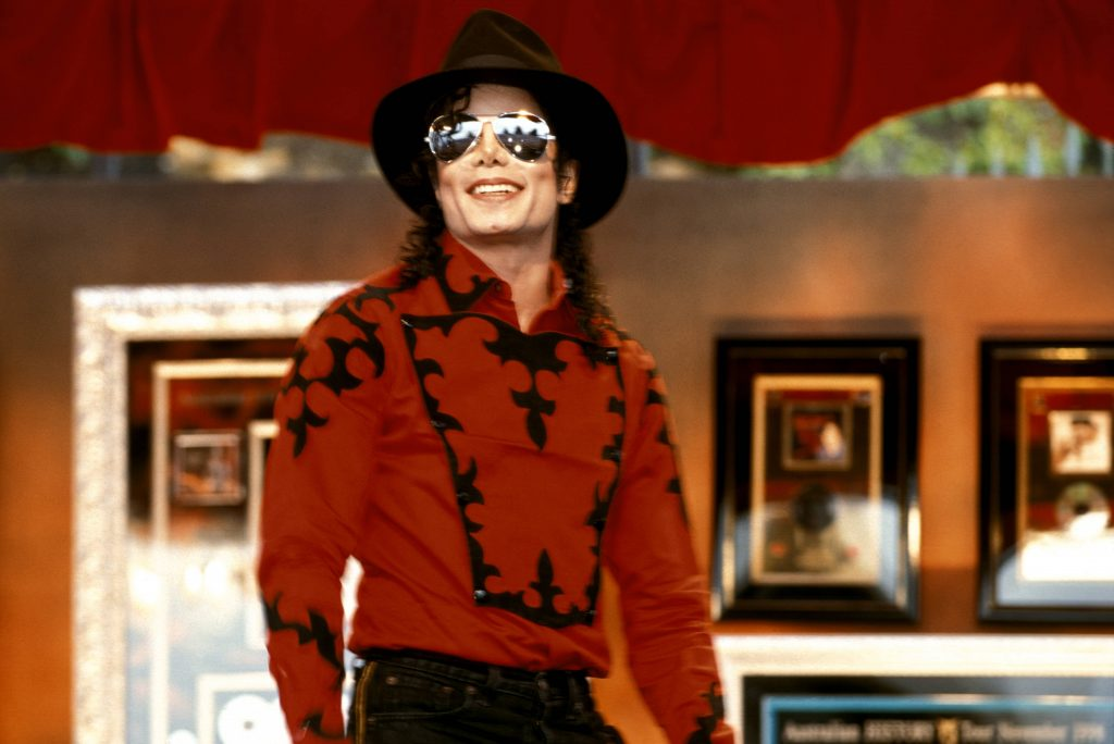 Portrait of Michael Jackson in 1996 wearing hat and sunglasses