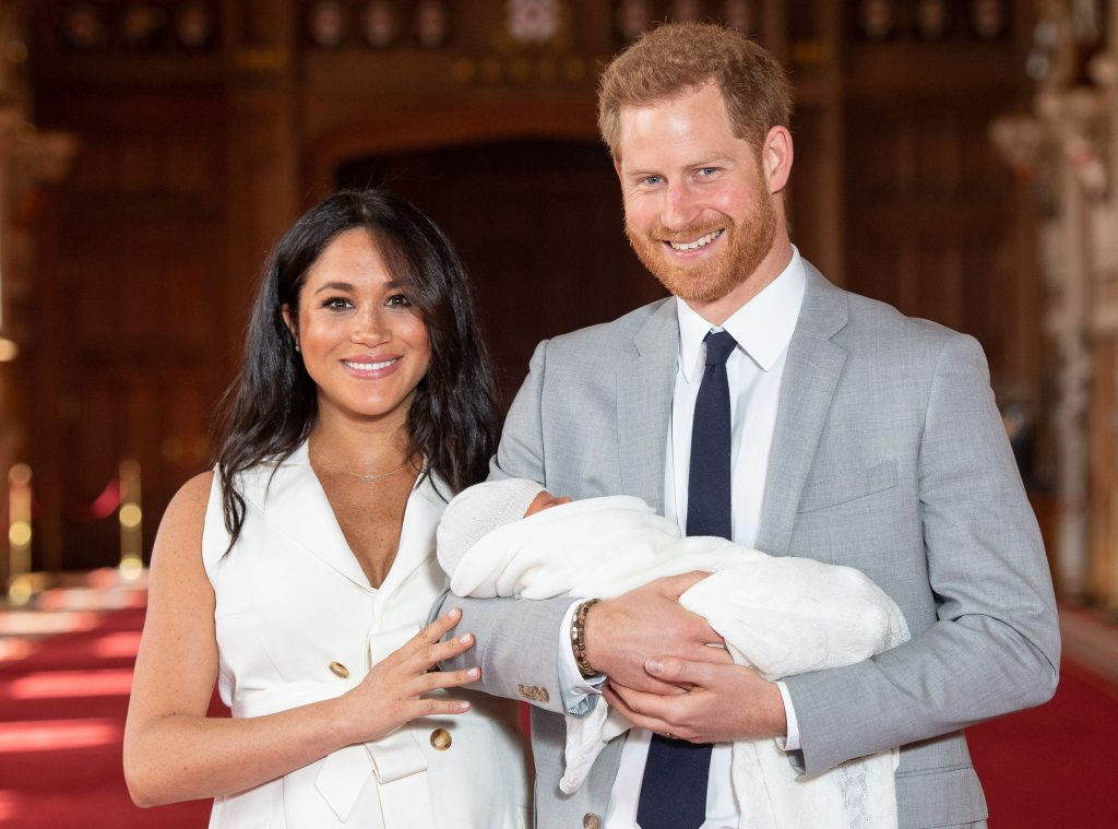 Prince Harry and Meghan Markle pose for a photo with their son, Archie Harrison Mountbatten-Windsor, days after he is born