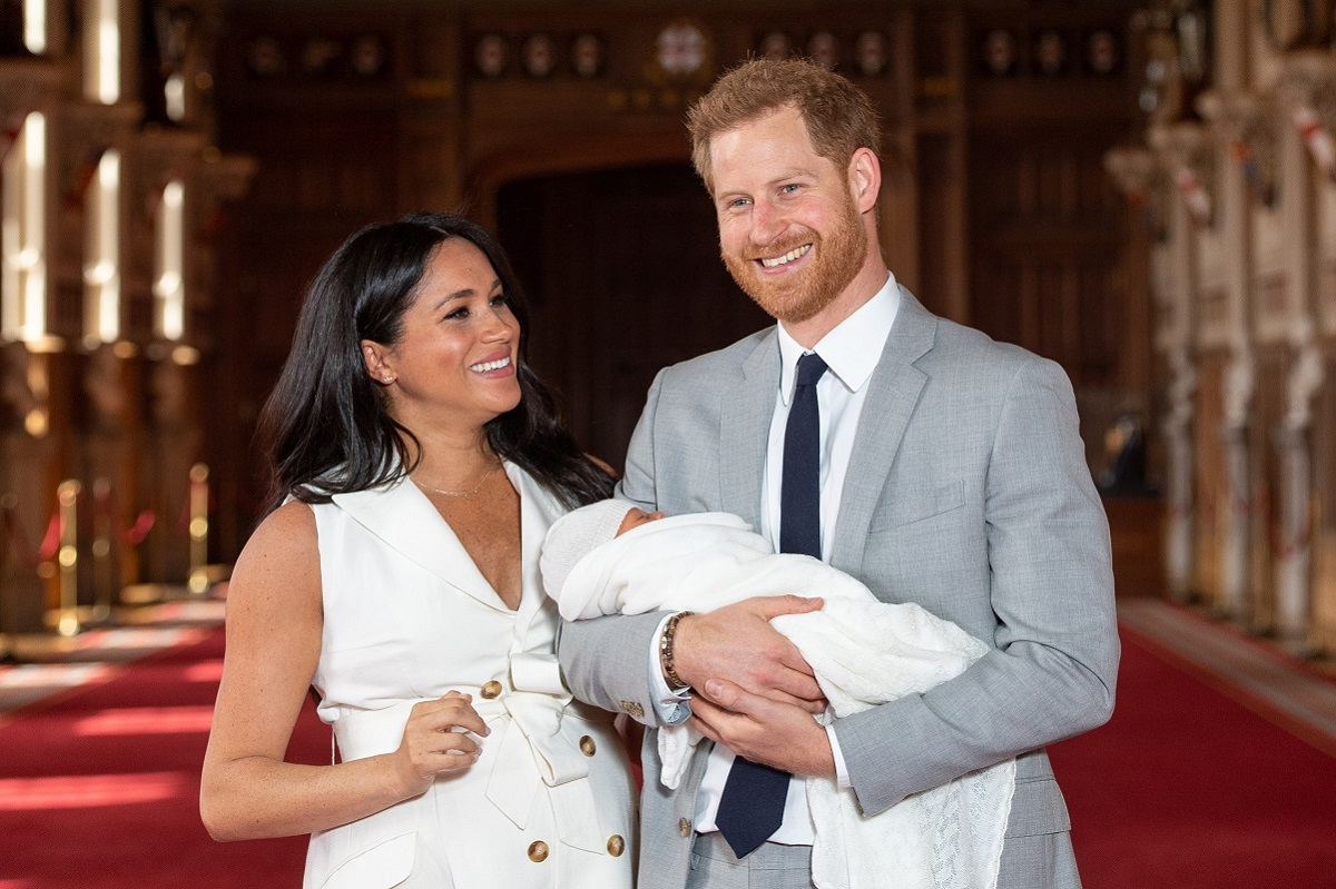Prince Harry and Meghan Markle pose with their son Archie Harrison Mountbatten-Windsor during a photocall days after his birth