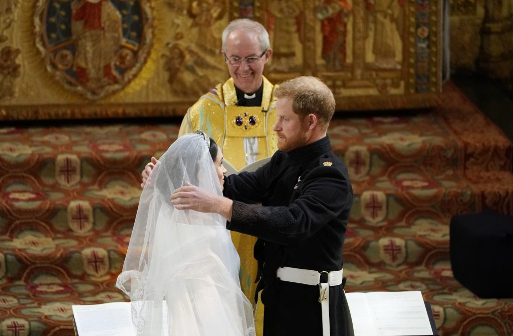 Prince Harry removes the veil of Meghan Markle at the altar before Archbishop of Canterbury Justin Welby
