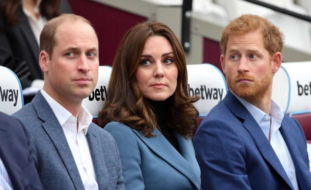 Prince William, Kate Middleton, and Prince Harry seated next to each other at the Coach Core graduation ceremony for over 150 apprentices