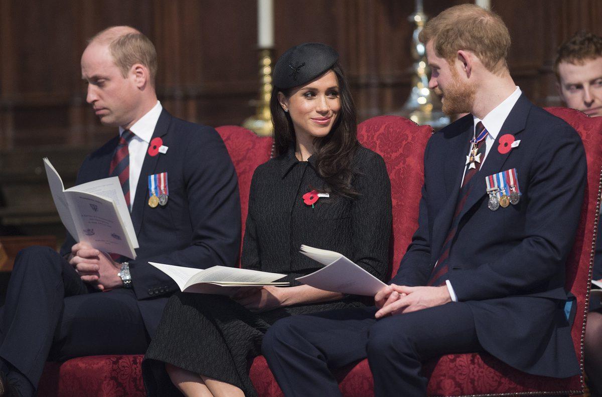 Prince William, Meghan Markle, and Prince Harry seated next to each other during an Anzac Day service at Westminster Abbey