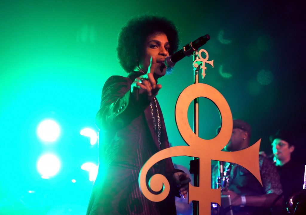 Prince singing onstage at The Hollywood Palladium in 2014