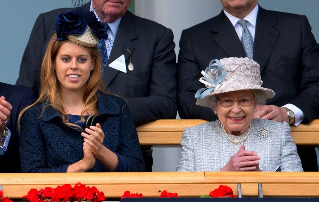 Princess Beatrice and Queen Elizabeth II clapping while in attendance at The QIPCO Champion Stakes