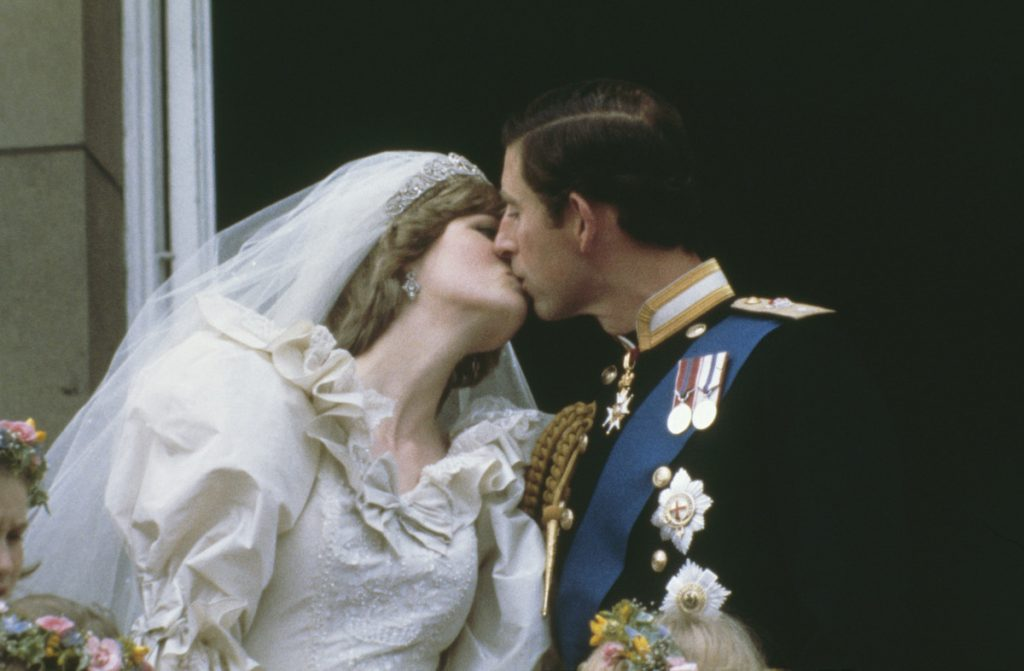 (L-R) Princess Diana and Prince Charles kissing on their wedding day