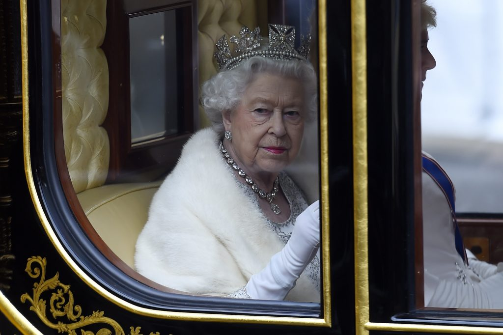 Queen Elizabeth II traveling in a carriage to State Opening Of Parliament