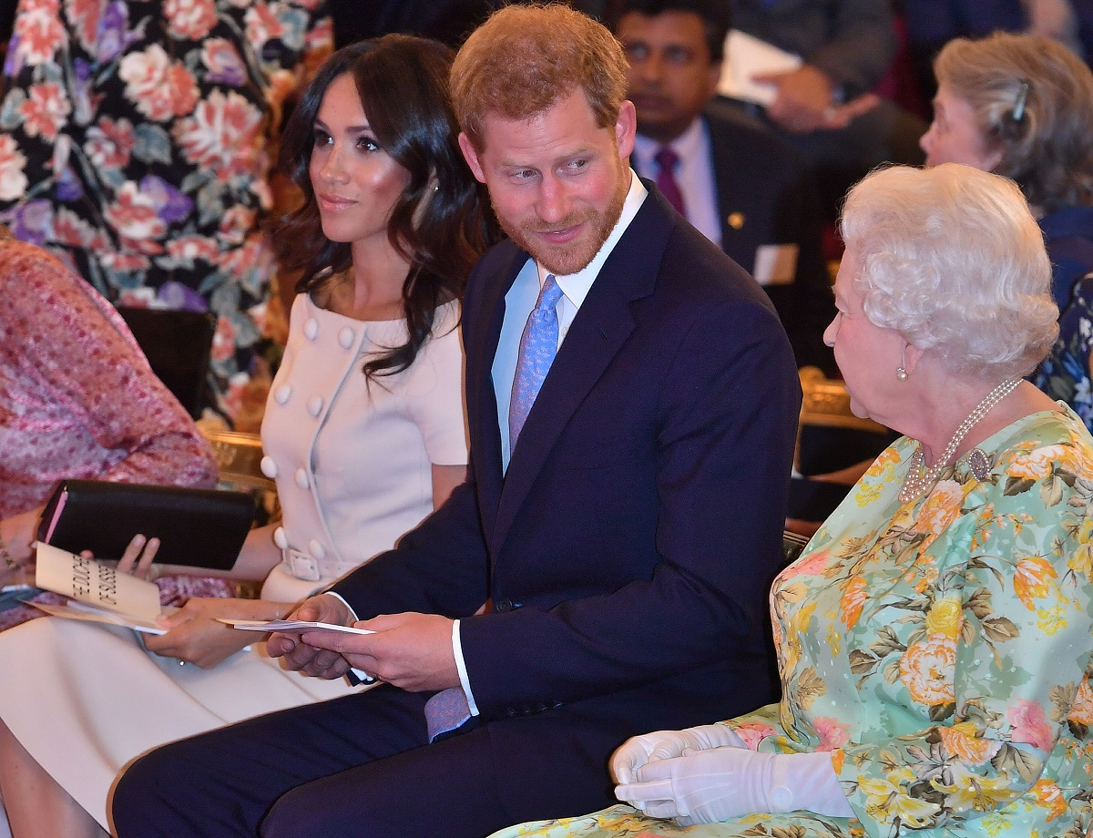 Queen Elizabeth II with Prince Harry, Duke of Sussex and Meghan, Duchess of Sussex at the Queen's Young Leaders Awards Ceremony at Buckingham Palace