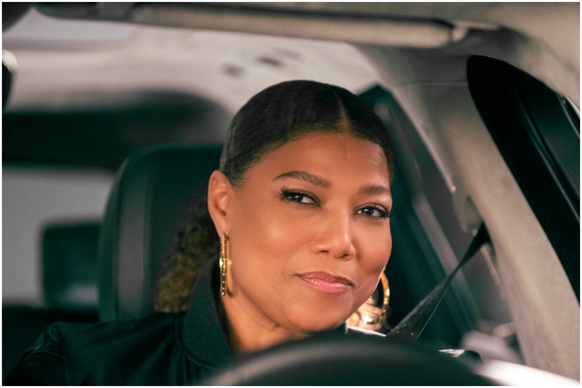 Queen Latifah sits in a car while filming an episode of 'The Equalizer'