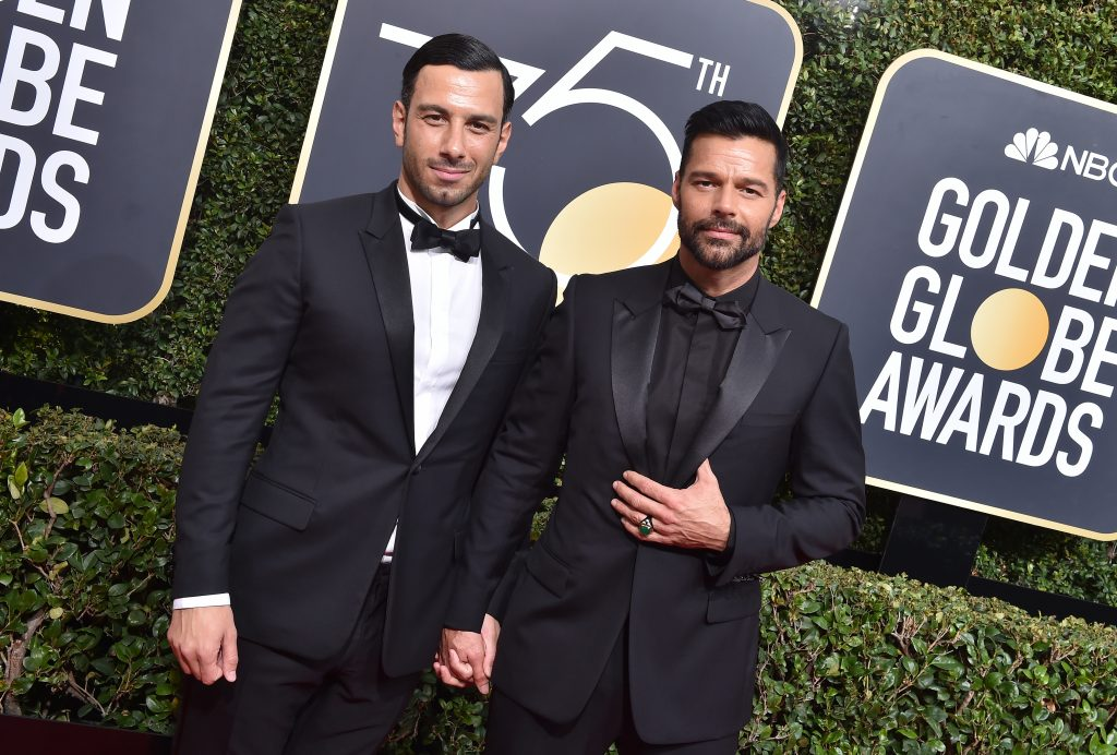 Ricky Martin and his spouse Jwan Yosef holding hands on the red carpet at the 75th Annual Golden Globe Awards