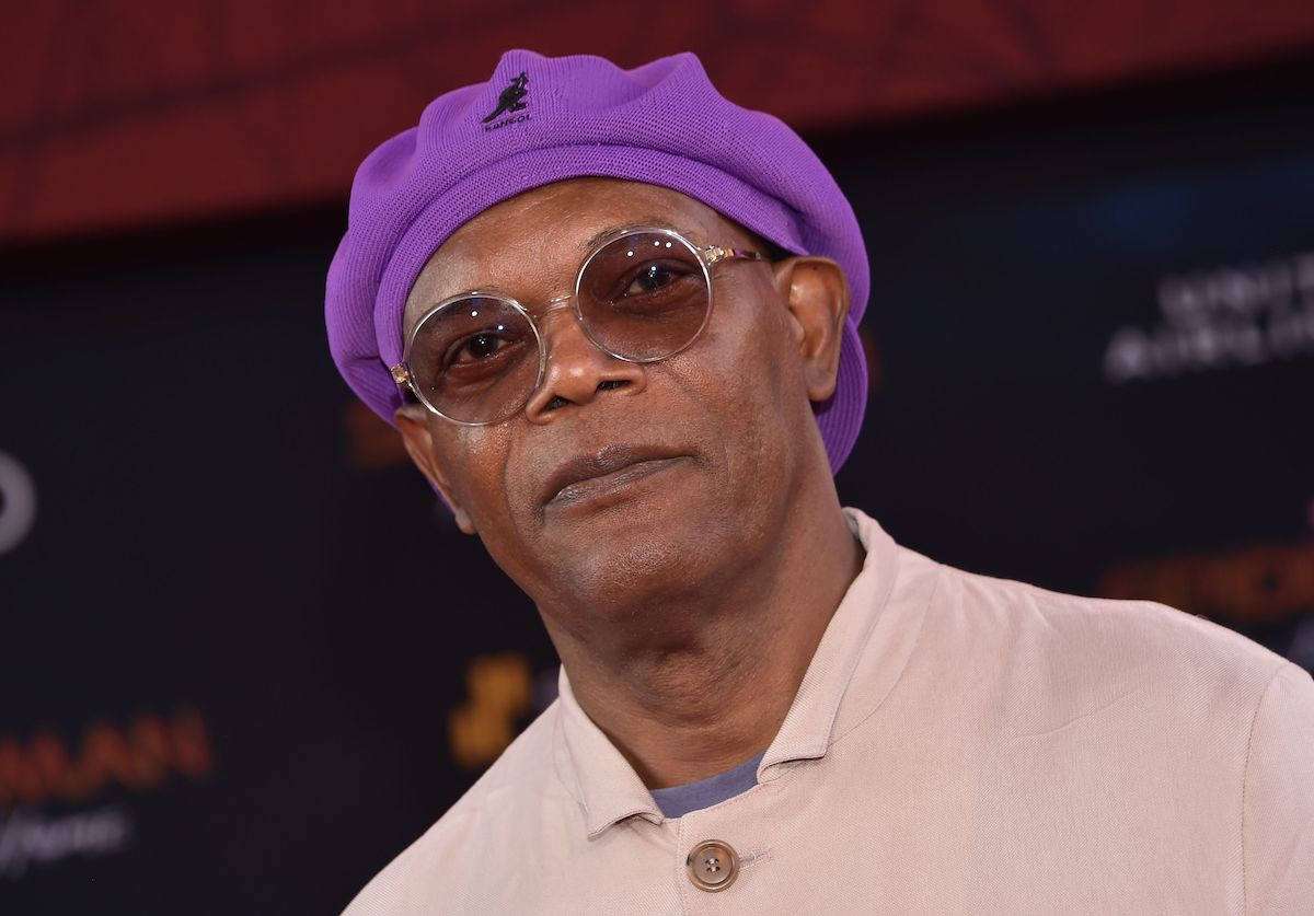 Samuel L. Jackson wears a purple hat and sunglasses at the 'Spider-Man: Far From Home' world premiere