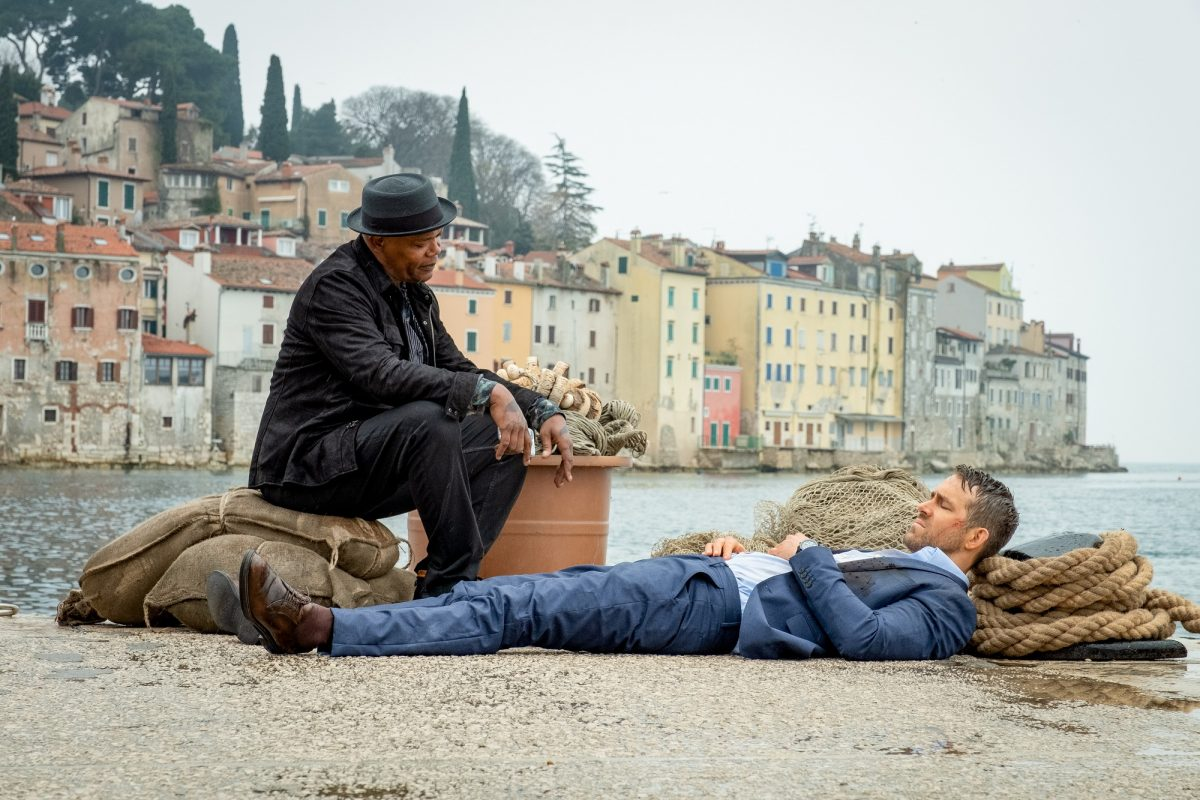 Samuel L. Jackson and Ryan Reynolds sit on the beach in Italy