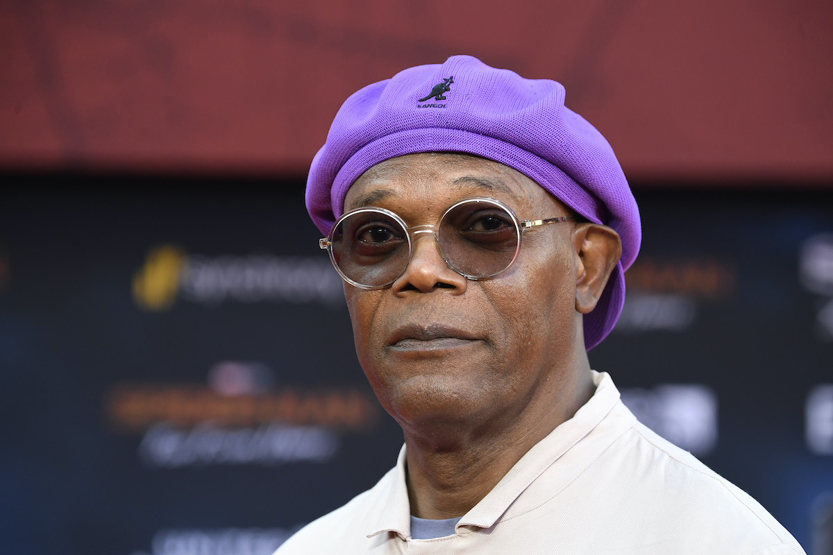 Samuel L. Jackson wears a purple hat and sunglasses at the 'Spider-Man: Far From Home' premiere