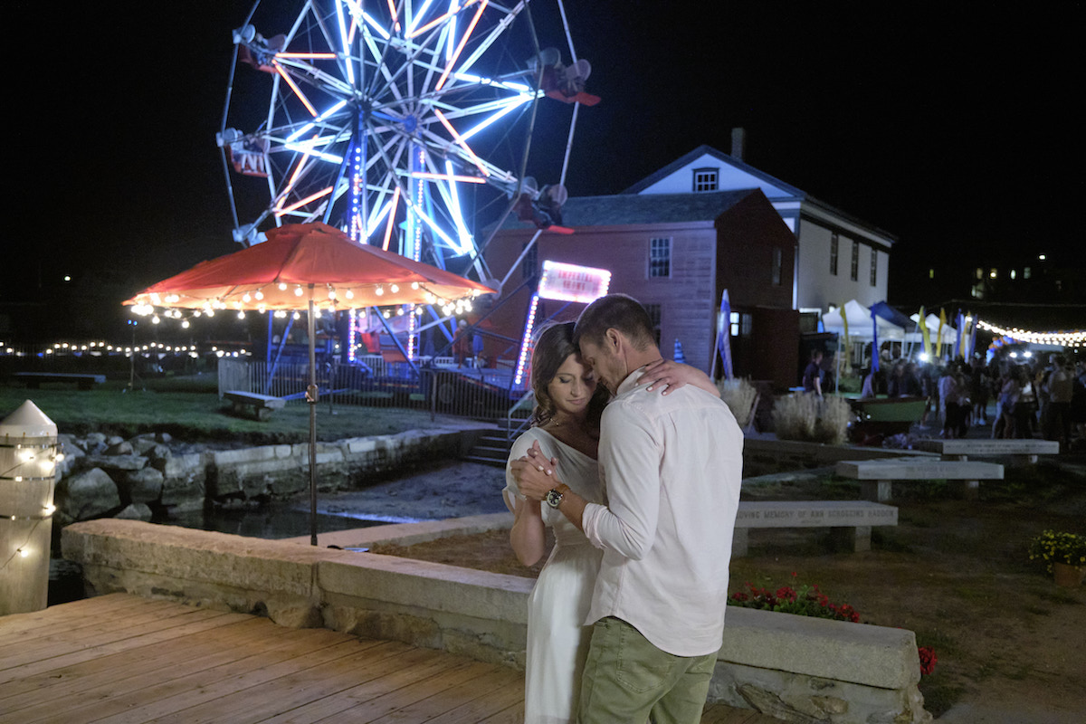 Aly Michalka and Chad Michael Murray dancing in front of a Ferris wheel in Sand Dollar Cove