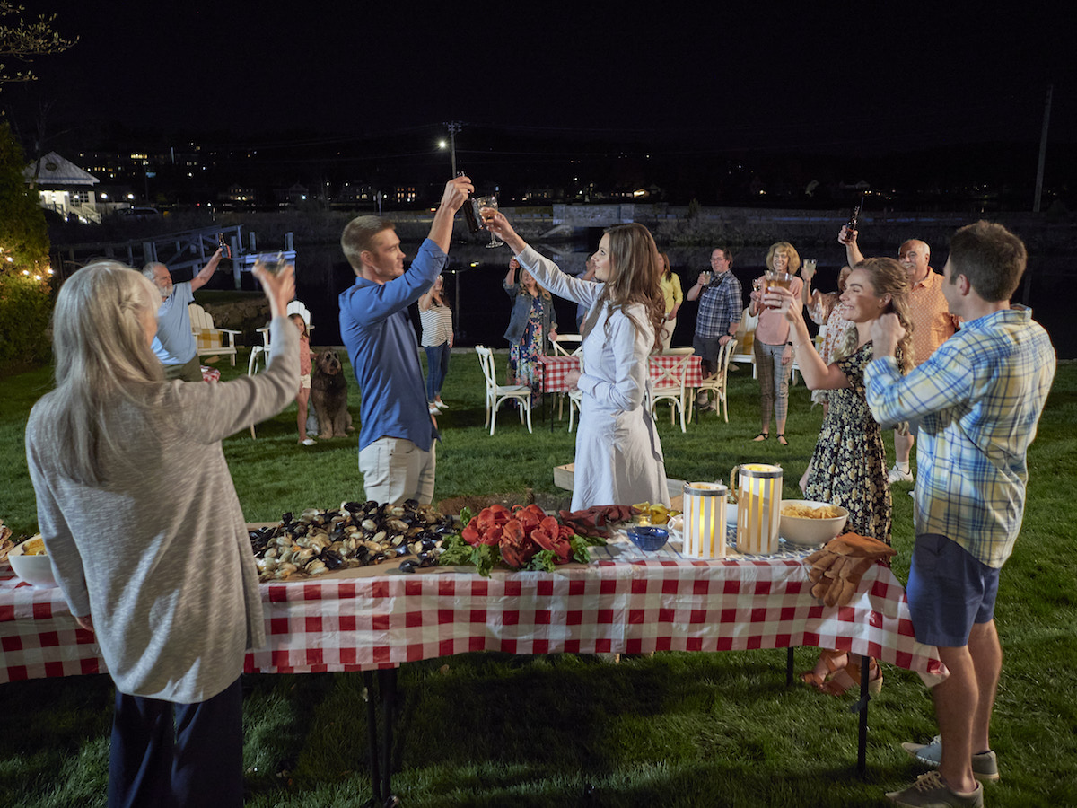 Chad Michael Murray and Aly Michalka toasting in Sand Dollar Cove movie