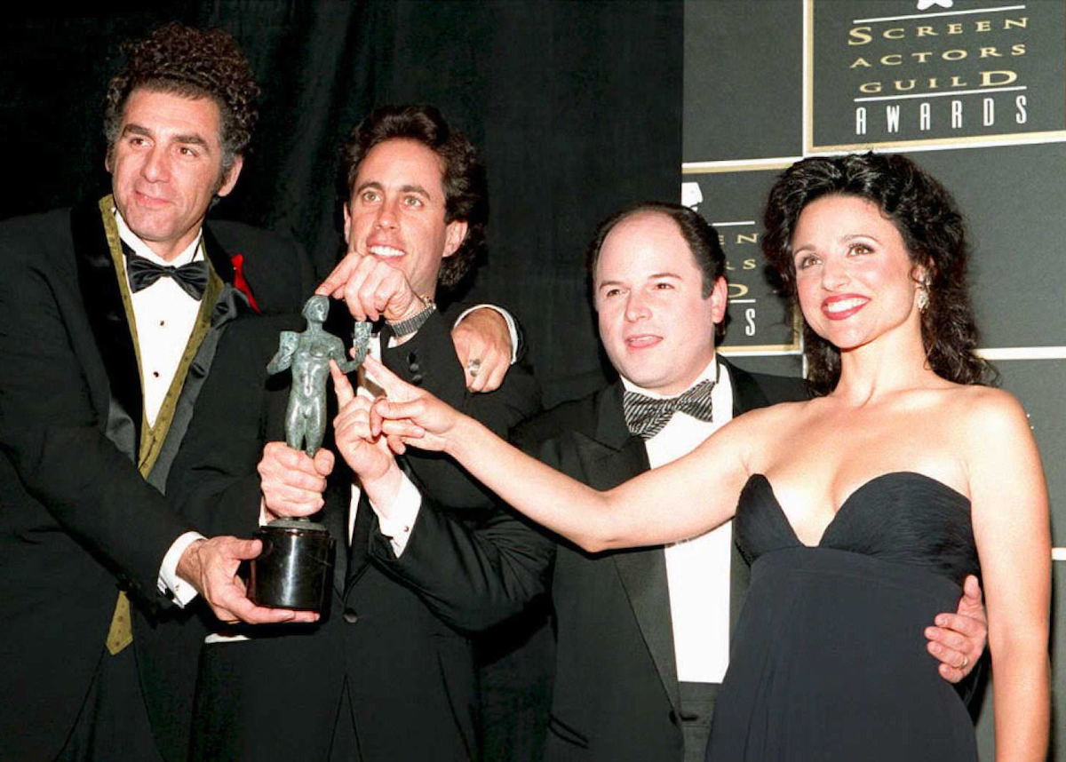 Michael Richards, Jerry Seinfeld, Jason Alexander, and Julia Louis-Dreyfus touch their Screen Actors Guild Award on a red carpet event