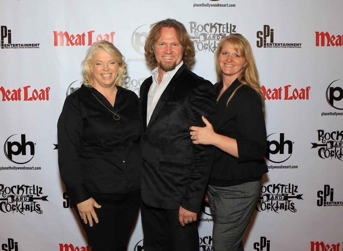 Janelle Brown, Kody Brown and Christine Brown pose for a photo during the 'Rocktellz & Cocktails presents Meat Loaf' event at Planet Hollywood Resort & Casino