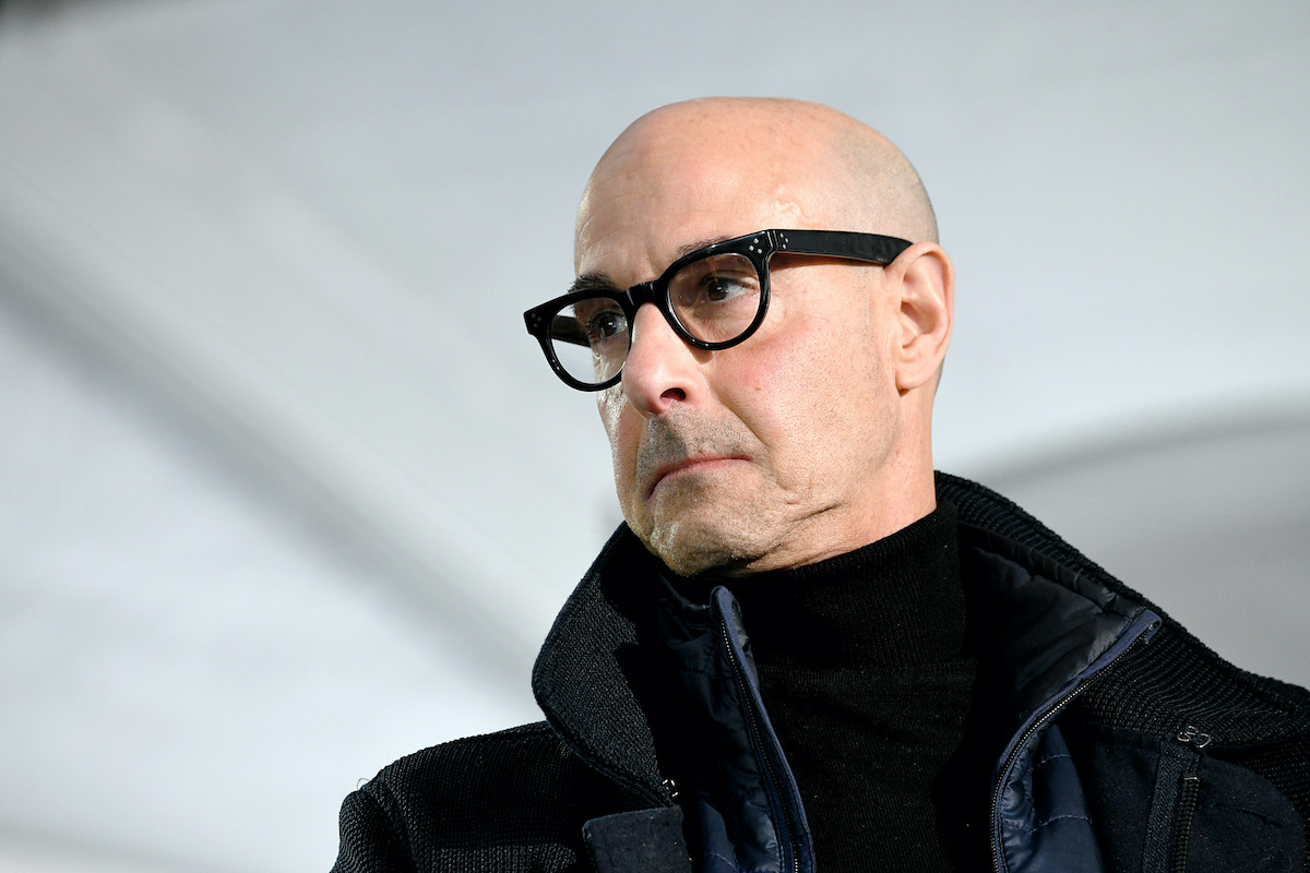 The Hunger Games alum Stanley Tucci in black glasses and a black jacket