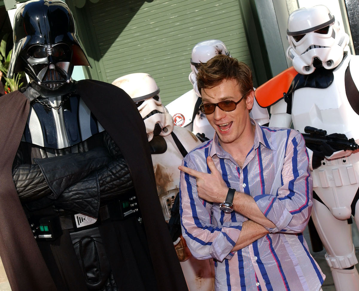 'Star Wars' actor Ewan McGregor wears a striped shirt and poses next to a life-size Darth Vader and stormtroopers